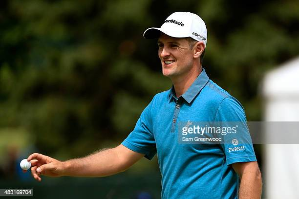 Justin Rose of England reacts after a birdie putt on the fifth green during the first round of the World Golf Championships - Bridgestone...