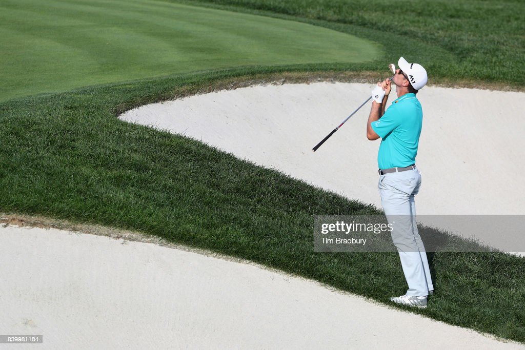 Justin Rose of England reacts after hitting from a greenside bunker on the 18th green during the final round of The Northern Trust at Glen Oaks Club on August 27, 2017 in Westbury, New York.