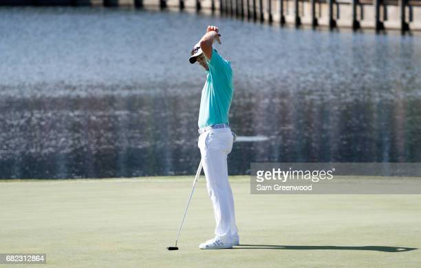 Justin Rose of England reacts on the 17th green during the second round of THE PLAYERS Championship at the Stadium course at TPC Sawgrass on May 12,...
