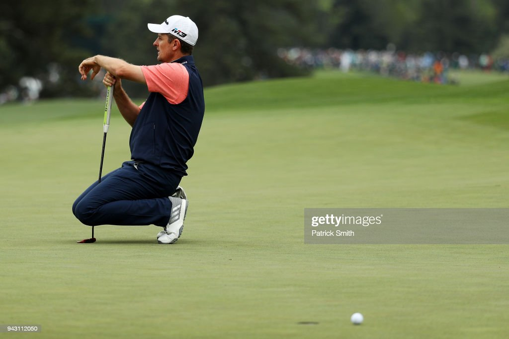 Justin Rose of England reacts to a missed putt on the eighth hole during the third round of the 2018 Masters Tournament at Augusta National Golf Club on April 7, 2018 in Augusta, Georgia.