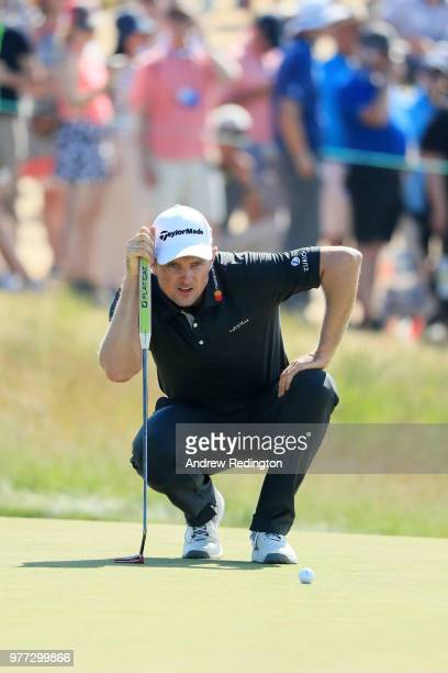 Justin Rose of England reacts to a missed putt on the ninth green during the final round of the 2018 US Open at Shinnecock Hills Golf Club on June 17...