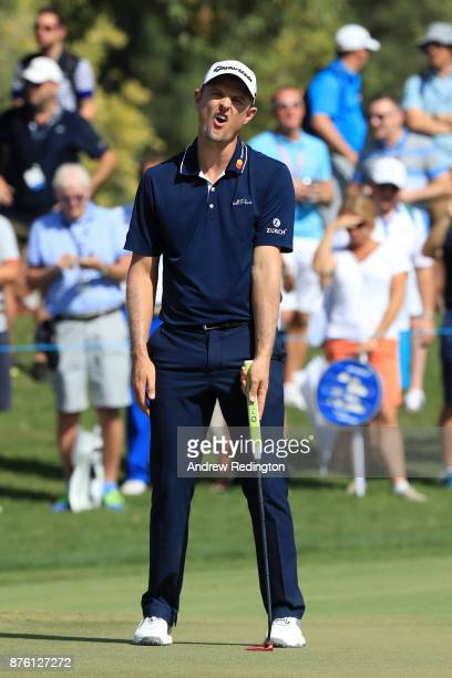 Justin Rose of England reacts to a putt on the 1st green during the final round of the DP World Tour Championship at Jumeirah Golf Estates on...