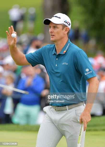 Justin Rose of England reacts to his birdie on the eighth green during the third round of the BMW Championship at Aronimink Golf Club on September 8...