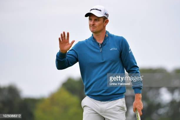 Justin Rose of England reacts to his birdie on the third green during the third round of the BMW Championship at Aronimink Golf Club on September 8,...