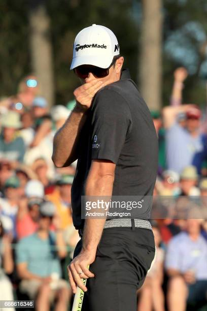 Justin Rose of England reacts to his missed birdie putt on the 18th hole during the final round of the 2017 Masters Tournament at Augusta National...