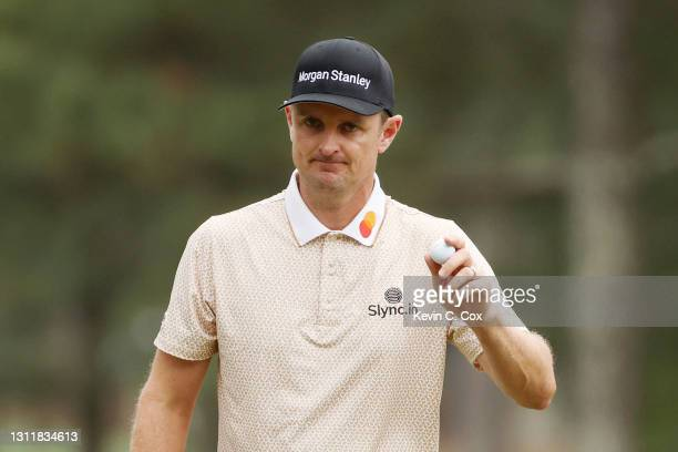 Justin Rose of England reacts to his putt on the third green during the third round of the Masters at Augusta National Golf Club on April 10, 2021 in...
