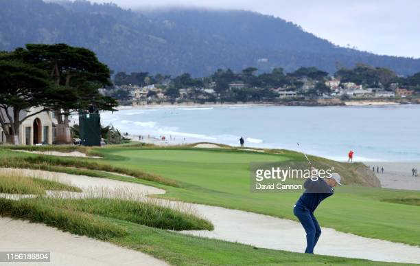 Justin Rose of England reacts to his second shot on the par 4 10th hole during the third round of the 2019 USOpen Championship at the Pebble Beach...