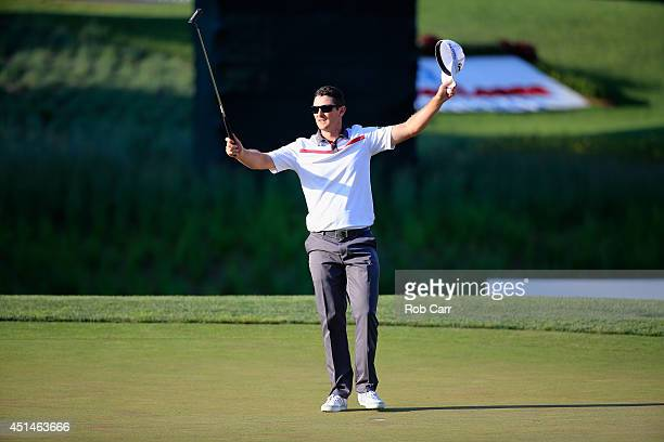 Justin Rose of England reacts to winning a playoff on the 18th green during the final round of the Quicken Loans National at Congressional Country...