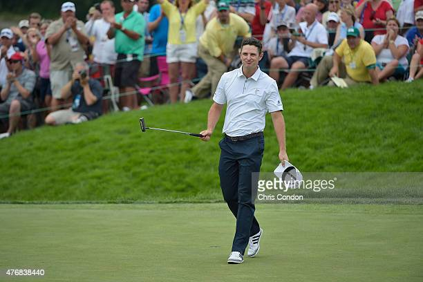 Justin Rose of England saves par on the 18th hole during the final round of the Memorial Tournament presented by Nationwide at Muirfield Village Golf...