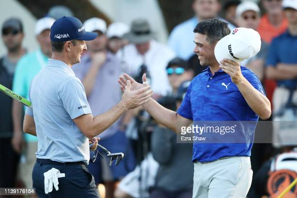 Justin Rose of England shakes hands with Gary Woodland of the United States after defeating him 1up during the third round of the World Golf...