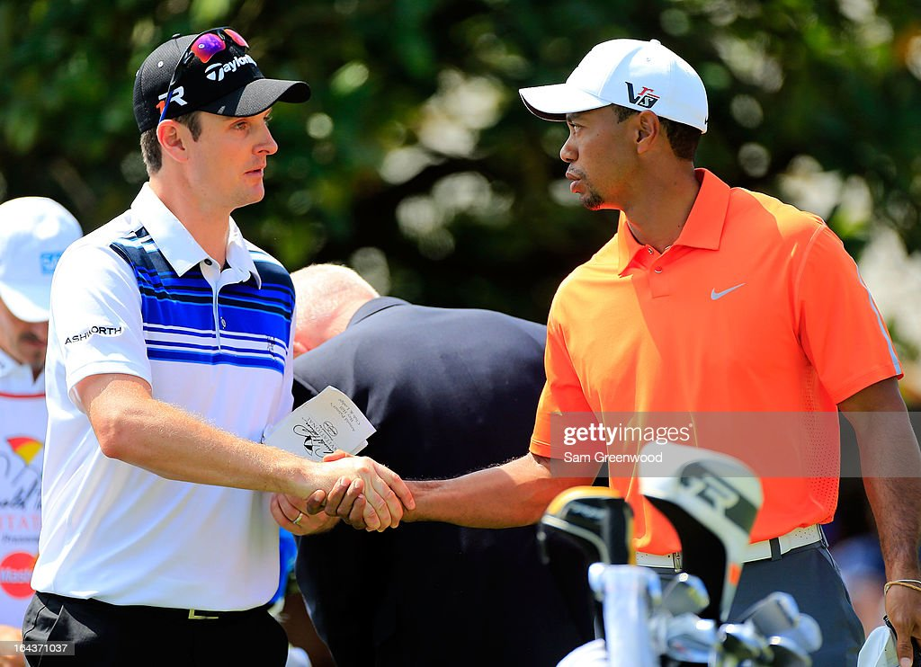 Justin Rose of England (L) shakes hands with Tiger Woods prior to the second round of the Arnold Palmer Invitational presented by MasterCard at the Bay Hill Club and Lodge on March 22, 2013 in Orlando, Florida.