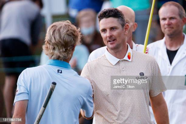 Justin Rose of England shakes hands with Will Zalatoris of the United States after their third round of the Masters at Augusta National Golf Club on...