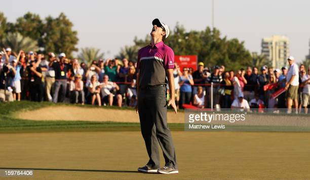 Justin Rose of England shows his frustration, after missing a putt on the 18th green to go to a play-off during day four of the Abu Dhabi HSBC Golf...