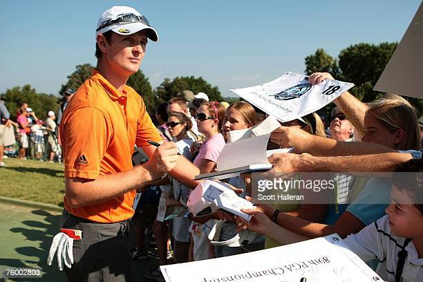 Justin Rose of England signs autographs for fans during a practice round prior to the start of the 89th PGA Championship at the Southern Hills...