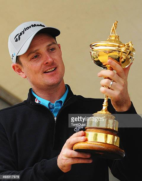 Justin Rose of England speaks to spectators on stage in the tented village with the Ryder Cup trophy during day two of the BMW PGA Championship at...