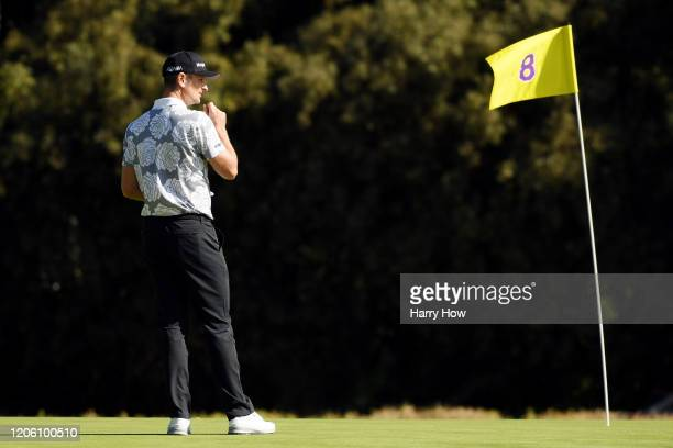 Justin Rose of England stands on the eighth green during the first round of the Genesis Invitational on February 13 2020 in Pacific Palisades...