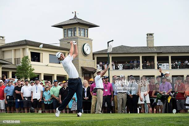 Justin Rose of England stees off on the 10th hole during the final round of the Memorial Tournament presented by Nationwide at Muirfield Village Golf...