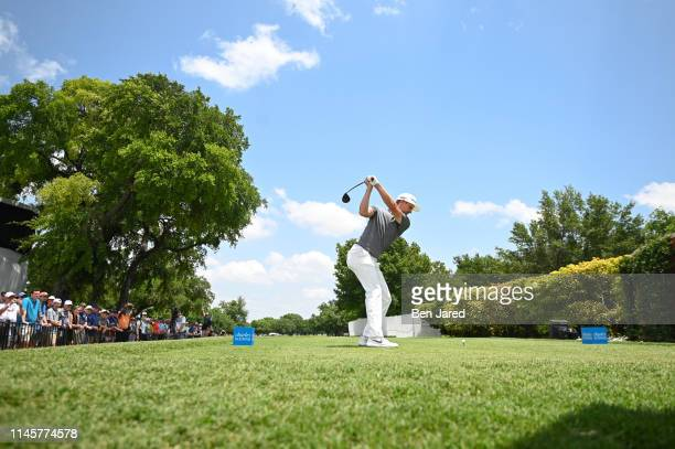 Justin Rose of England swings on the first tee during the first round of the Charles Schwab Challenge at Colonial Country Club on May 23 2019 in Fort...