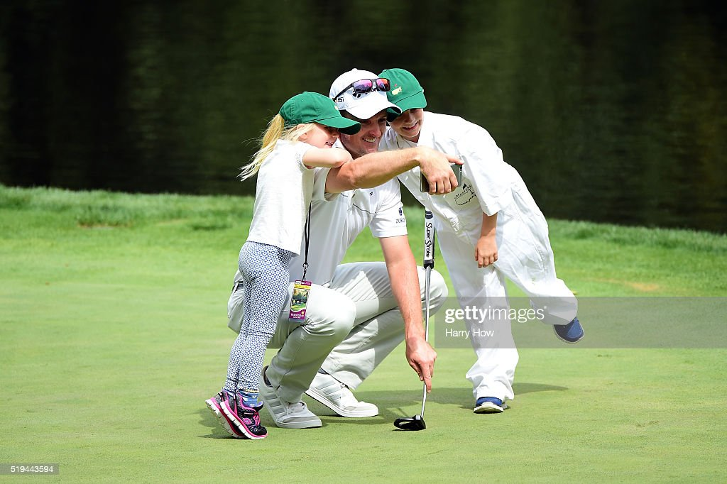 Justin Rose of England talks to his children Leo and Charlotte during the Par 3 Contest prior to the start of the 2016 Masters Tournament at Augusta National Golf Club on April 6, 2016 in Augusta, Georgia.