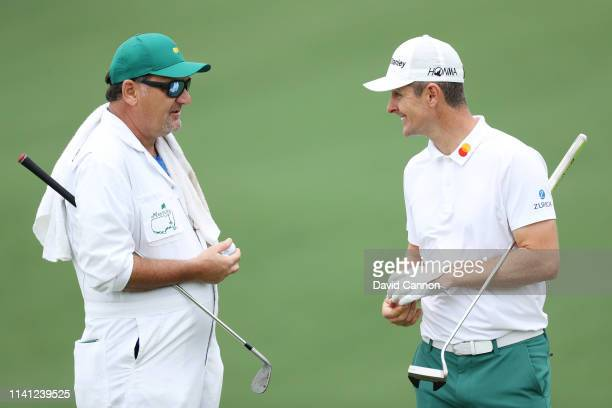 Justin Rose of England talks with his caddie Mark Fulcher during a practice round prior to The Masters at Augusta National Golf Club on April 08 2019...