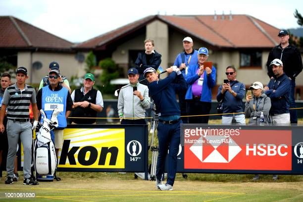 Justin Rose of England tees off at the 12th hole while on a practice round during previews to the 147th Open Championship at Carnoustie Golf Club on...