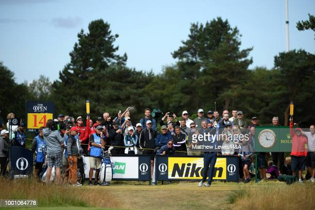 Justin Rose of England tees off on the 14th tee while playing a practice round during previews to the 147th Open Championship at Carnoustie Golf Club...