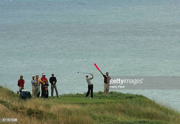Justin Rose of England tees off on the 18th green during the practice round of the US PGA Championship at the Whistling Straits Golf Course August...