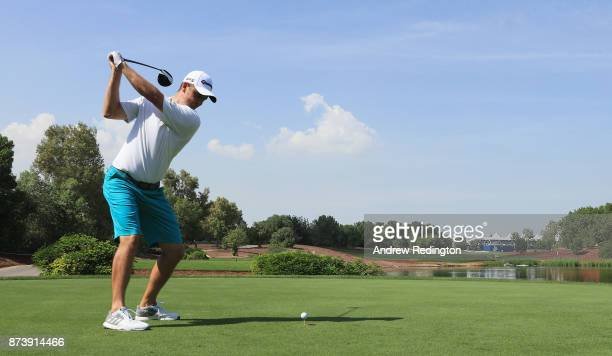 Justin Rose of England tees off on the 18th hole during the Pro-Am prior to the DP World Tour Championship at Jumeirah Golf Estates on November 14,...