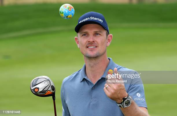 Justin Rose of England, the 'World Number One' poses with a mini globe during the pro-am event prior to the Saudi International at the Royal Greens...