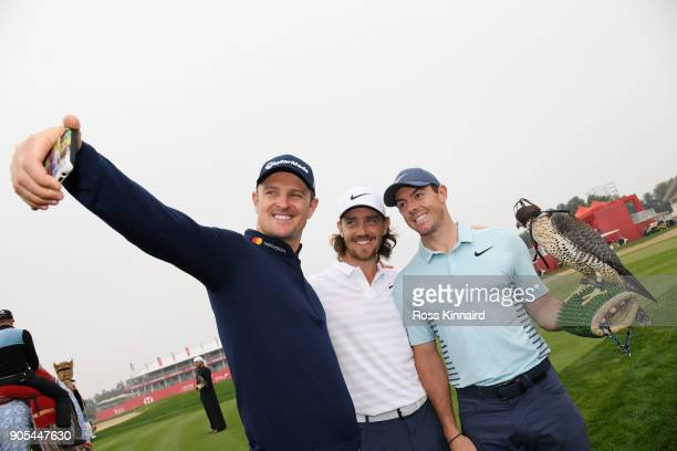 Justin Rose of England Tommy Fleetwood of England and Rory McIlroy of Northern Ireland take part in a photocall for the Abu Dhabi HSBC Golf...