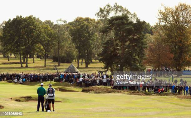 Justin Rose of England waits with his caddiie on the third hole on Day Two of the Sky Sports British Masters at Walton Heath Golf Club on October 12...