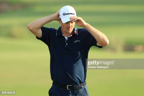 Justin Rose of England walks down the 18th hole during the final round of the DP World Tour Championship at Jumeirah Golf Estates on November 19 2017...