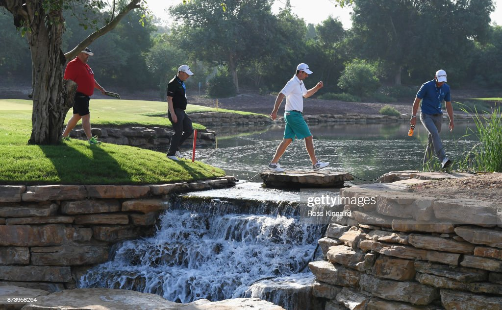 Justin Rose (2ndR) of England walks off the 6th green during the Pro-Am prior to the DP World Tour Championship at Jumeirah Golf Estates on November 14, 2017 in Dubai, United Arab Emirates.