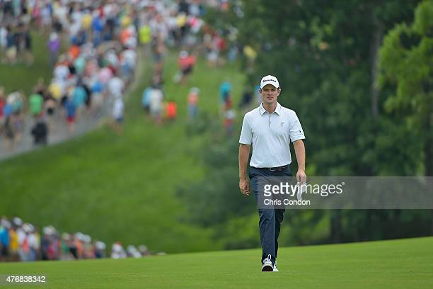 Justin Rose of England walks the 10th fairway during the final round of the Memorial Tournament presented by Nationwide at Muirfield Village Golf...