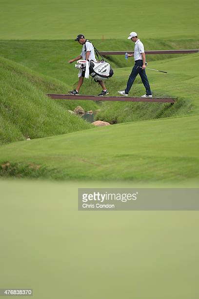 Justin Rose of England walks the 11th fairway during the final round of the Memorial Tournament presented by Nationwide at Muirfield Village Golf...