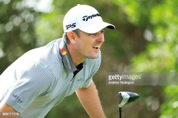 Justin Rose of England watches his shot from the eighth tee during the final round of the Abu Dhabi HSBC Golf Championship at Abu Dhabi Golf Club on...