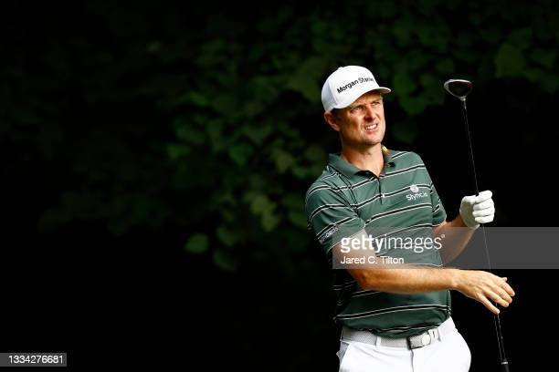 Justin Rose of England watches his shot from the second tee during the final round of the Wyndham Championship at Sedgefield Country Club on August...
