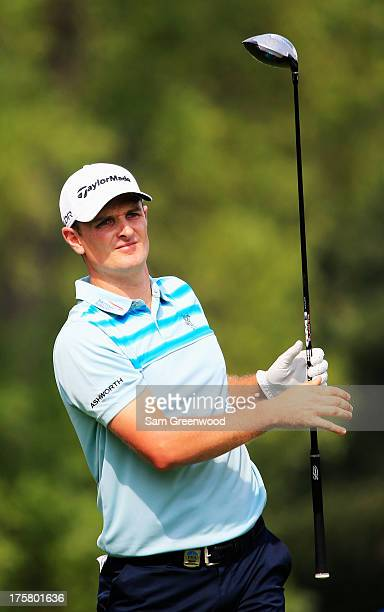 Justin Rose of England watches his tee shot during the first round of the 95th PGA Championship on August 8 2013 in Rochester New York