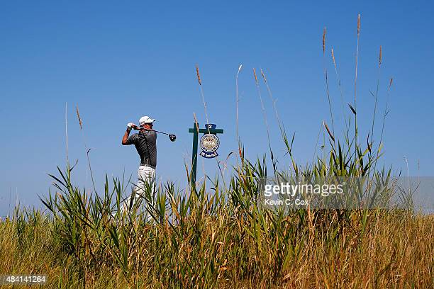 Justin Rose of England watches his tee shot on the second hole during the third round of the 2015 PGA Championship at Whistling Straits on August 15...