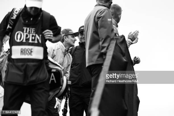 Justin Rose of England watches other players off the first tee during the final round of the 148th Open Championship held on the Dunluce Links at...