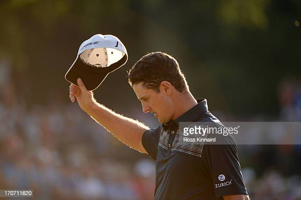 Justin Rose of England waves after putting on the 18th hole to complete the final round of the 113th U.S. Open at Merion Golf Club on June 16, 2013...