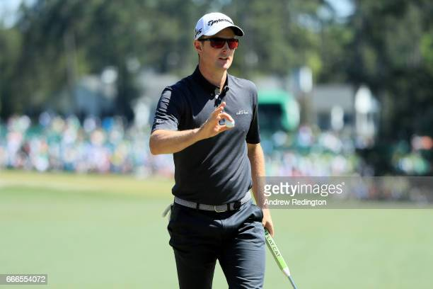 Justin Rose of England waves after putting on the first hole during the final round of the 2017 Masters Tournament at Augusta National Golf Club on...