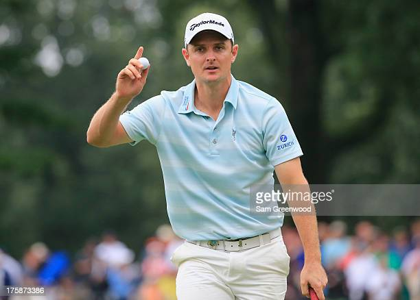 Justin Rose of England waves after putting on the ninth green during the second round of the 95th PGA Championship on August 9 2013 in Rochester New...