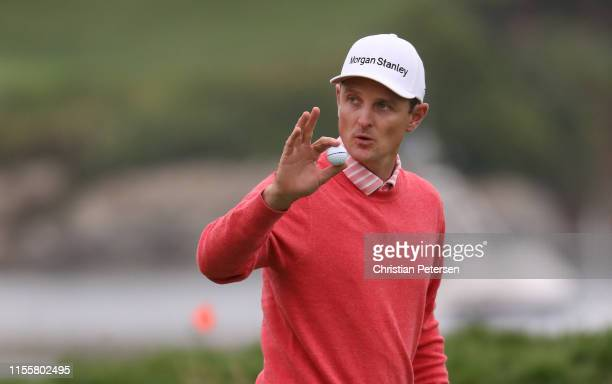 Justin Rose of England waves to the crowd on the 17th green during the first round of the 2019 U.S. Open at Pebble Beach Golf Links on June 13, 2019...