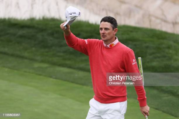 Justin Rose of England waves to the crowd on the 18th green during the first round of the 2019 U.S. Open at Pebble Beach Golf Links on June 13, 2019...