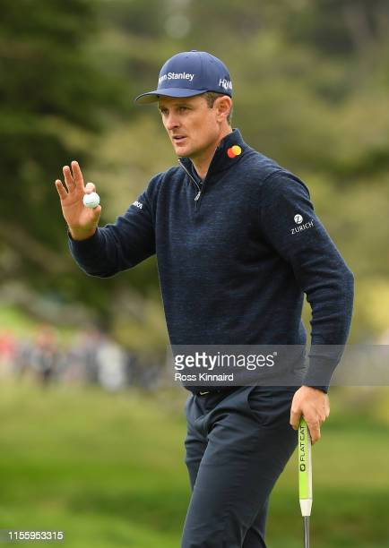 Justin Rose of England waves to the crowd on the second green during the second round of the 2019 U.S. Open at Pebble Beach Golf Links on June 14,...
