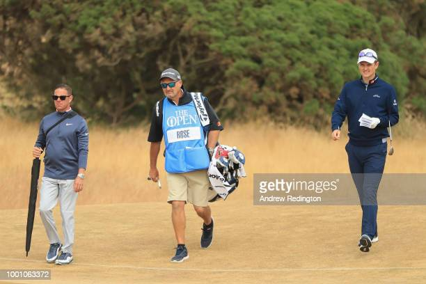 Justin Rose of England with his caddie Mark Fulcher and coach Sean Foley on the 12th hole during previews to the 147th Open Championship at...