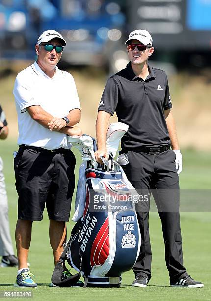 Justin Rose of Englandwith his caddie Mark Fulcher still using his Olympic team golf bag during the proam as a preview for The Barclays in the PGA...