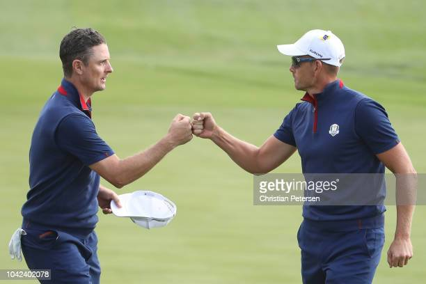 Justin Rose of Europe and Henrik Stenson of Europe celebrate during the afternoon foursome matches of the 2018 Ryder Cup at Le Golf National on...