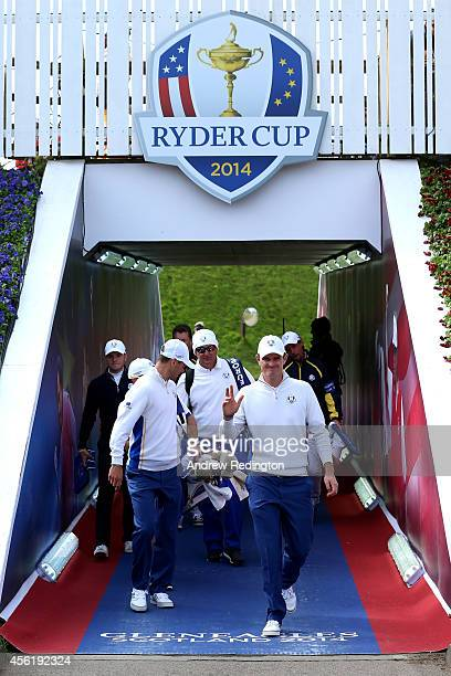 Justin Rose of Europe and Martin Kaymer of Europe walk through the tunnel before the Afternoon Foursomes of the 2014 Ryder Cup on the PGA Centenary...